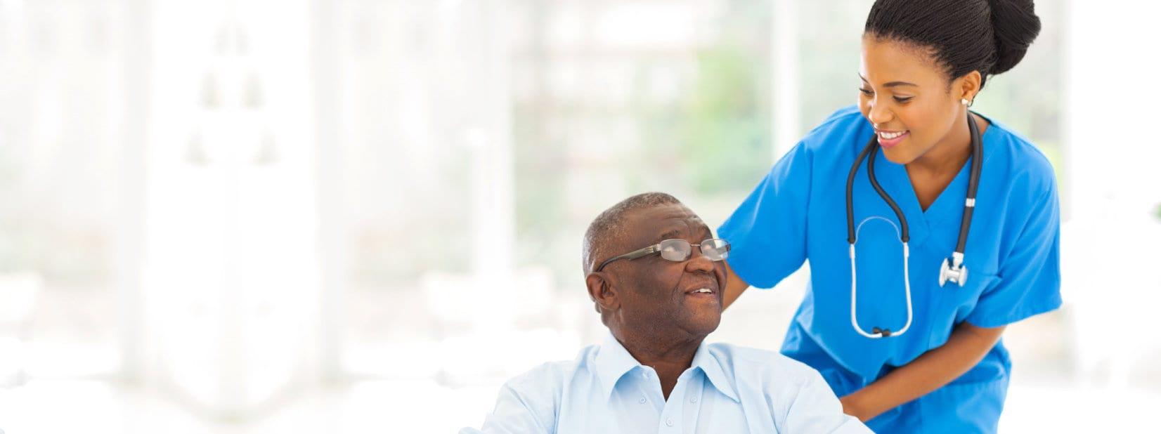 nurse and elder man smiling