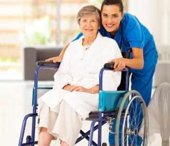 elderly woman and nurse smiling